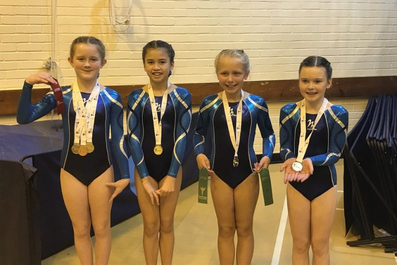 ETKO gymnasts with their medals.
