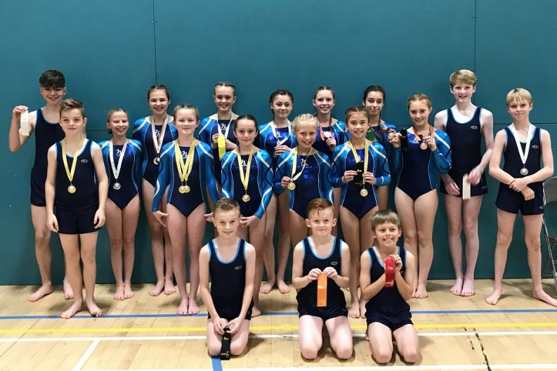 Gymnasts from ETKO Gymnastics with their medals and ribbons